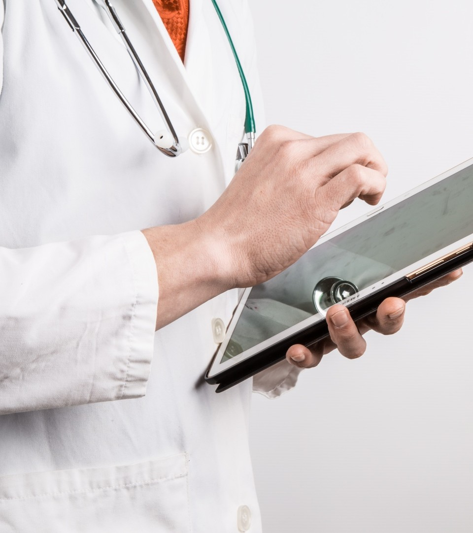 physician tapping on electronic tablet